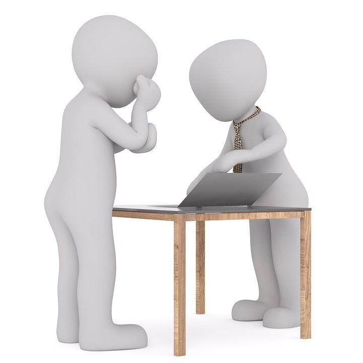 oral de francais, on voit un examinateur avec une cravate et un candidat préoccupé qui attend son sujet.